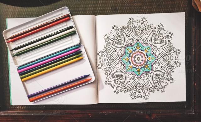 stock-photo-drawing-coloring-mandala-colored-pencils-3ddb2e73-ec13-4140-b60e-58a47b272d31