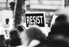 monochrome-photo-of-resist-signage-3141240