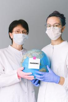 people-with-face-masks-and-latex-gloves-holding-a-globe-4167560
